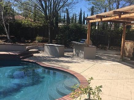 Pergola and landscaping in backyard