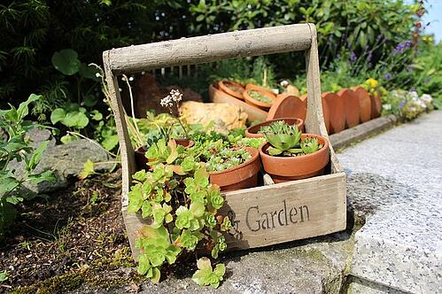Gardening container for outdoor kitchen